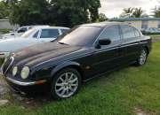 Se vende Jaguar negro en excelentes condiciones